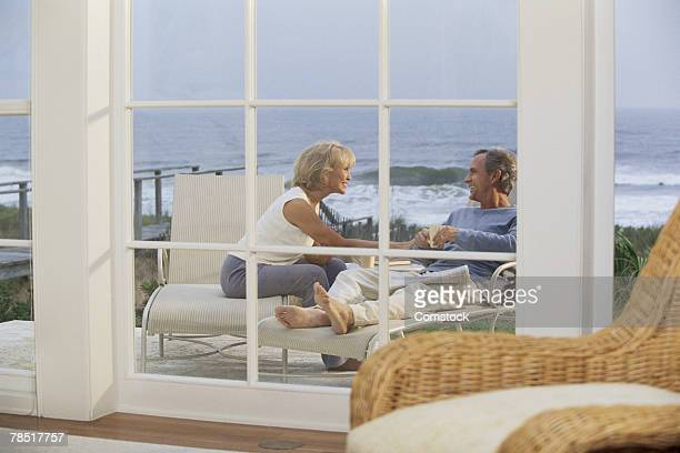 Couple sitting outdoors at beach house