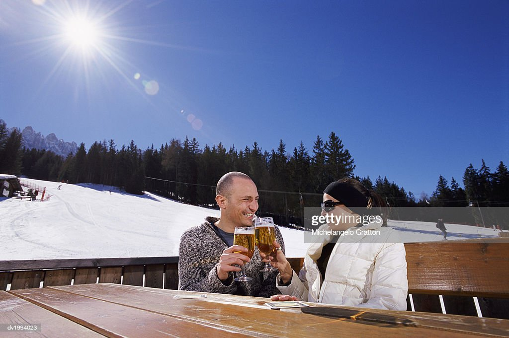Couple Sitting Outdoors Making a Toast : Stock Photo