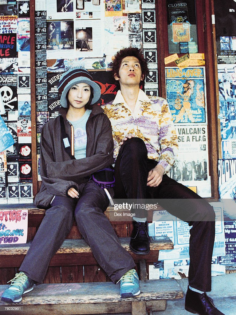 Couple sitting outside a shop : Stock Photo