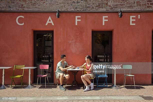 couple sitting outside cafe, florence, tuscany, italy - florence italy foto e immagini stock