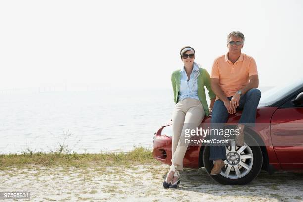 couple sitting - next to stock pictures, royalty-free photos & images
