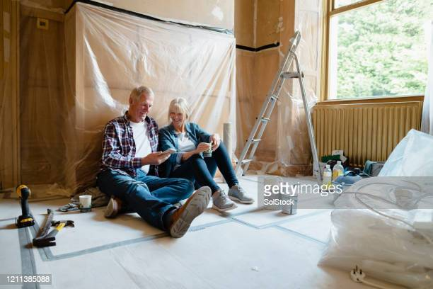couple sitting relaxing - renovation stock pictures, royalty-free photos & images