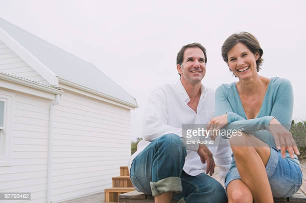 Couple sitting together and smiling