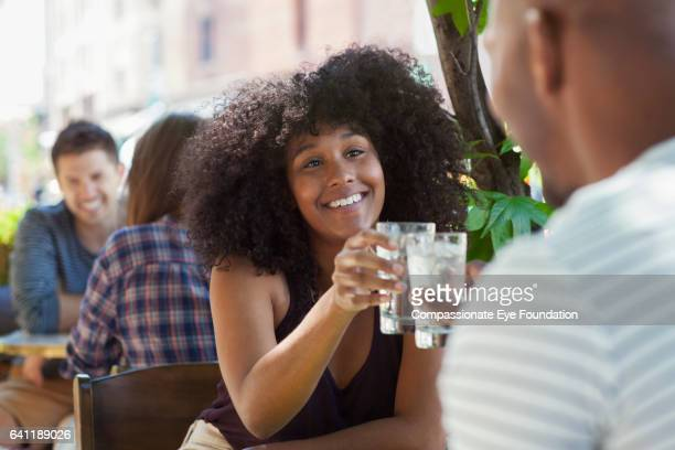 couple sitting together in restaurant - cef do not delete stock pictures, royalty-free photos & images