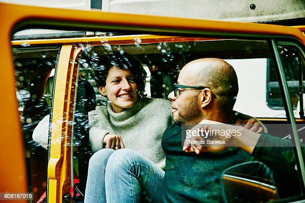 Couple sitting together in van after hike