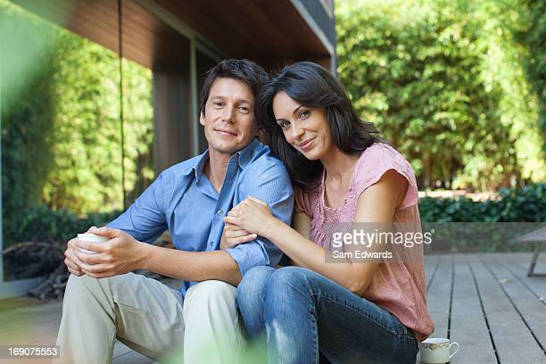 couple sitting together on patio - 30 39 years stock pictures, royalty-free photos & images
