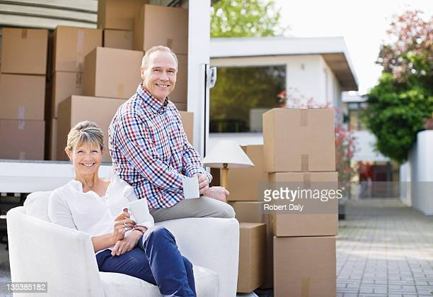 Couple sitting with moving and boxes