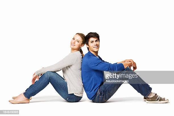 Couple Sitting With Their Backs Together - Isolated