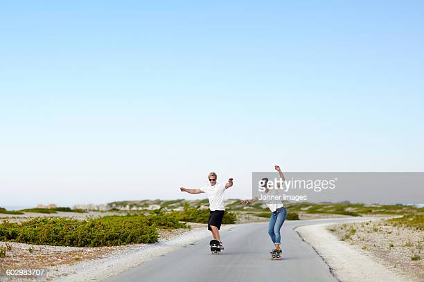 Couple skateboarding
