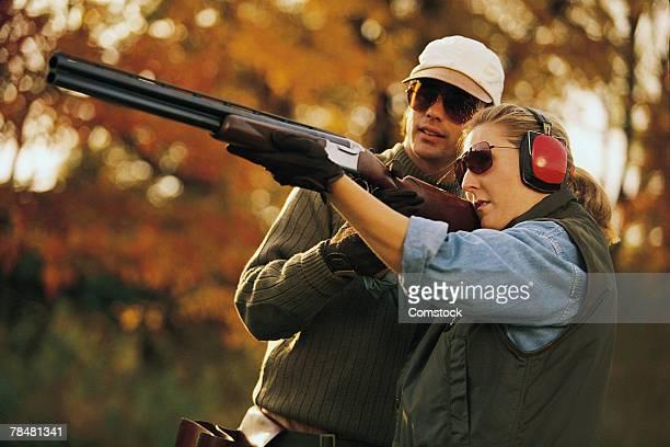 Couple skeet shooting