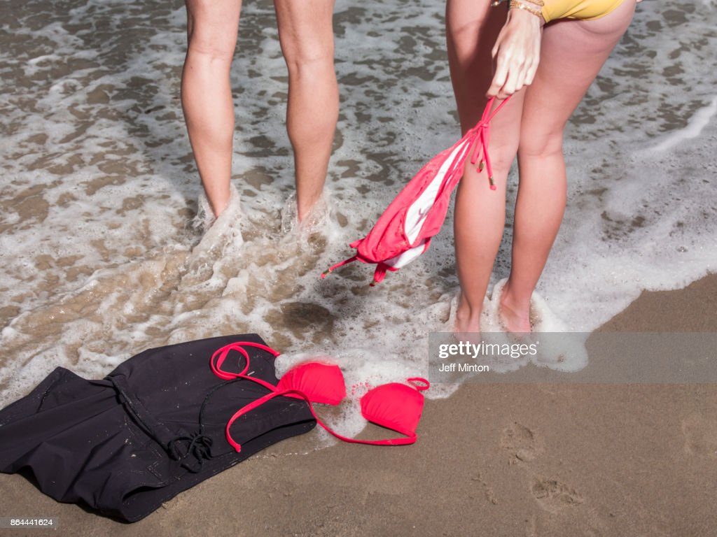 Couple skinny dipping by the sea : Stock Photo