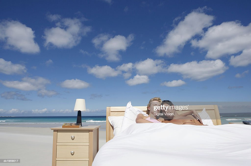 Couple Sleeping in a Bed on the Beach : Stock Photo