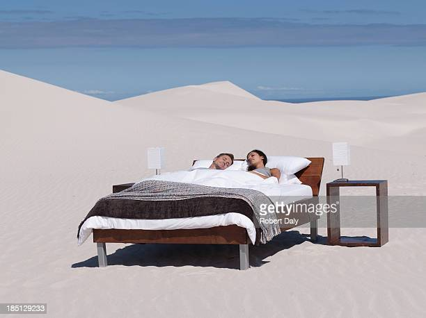 a couple sleeping in a bed outdoors - double bed stock pictures, royalty-free photos & images