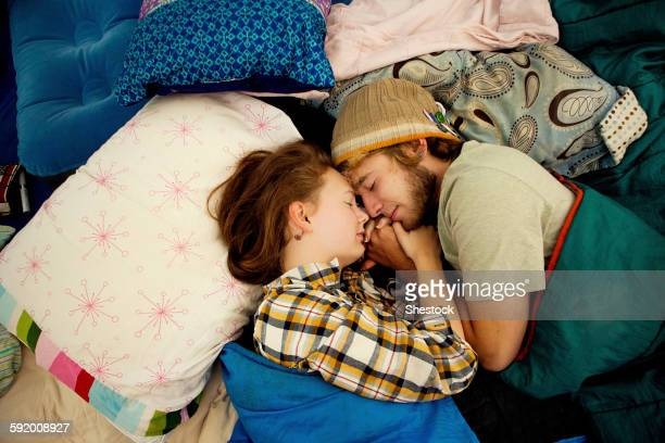 Couple sleeping in camping tent
