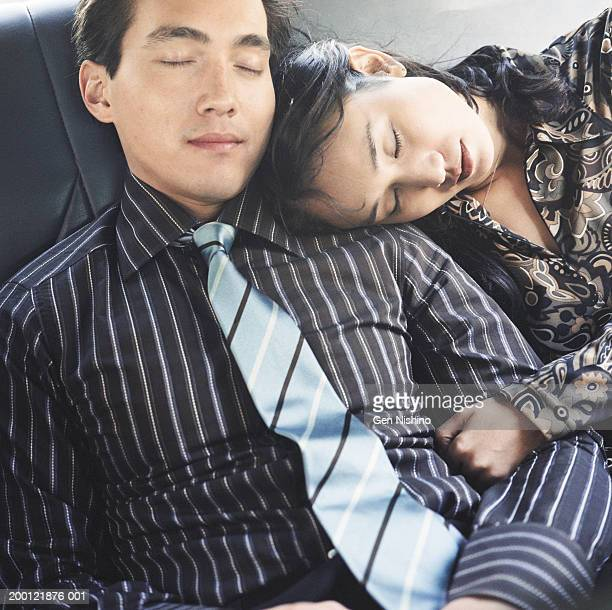 Couple sleeping in taxi cab