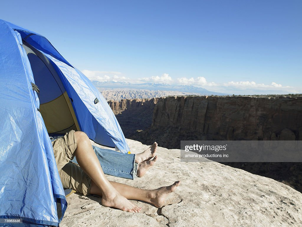 Couple sleeping in tent by cliff Moab Utah USA & Couple Sleeping In Tent By Cliff Moab Utah Usa Stock Photo | Getty ...