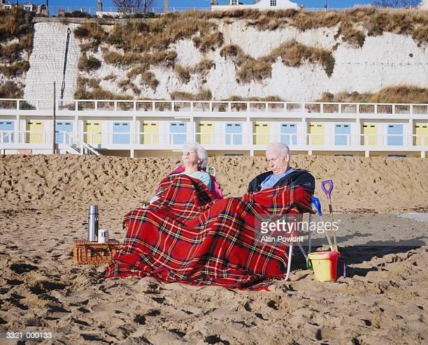 Couple Sleeping on Beach