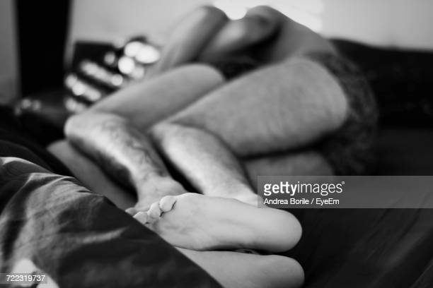Couple Sleeping On Bed At Home