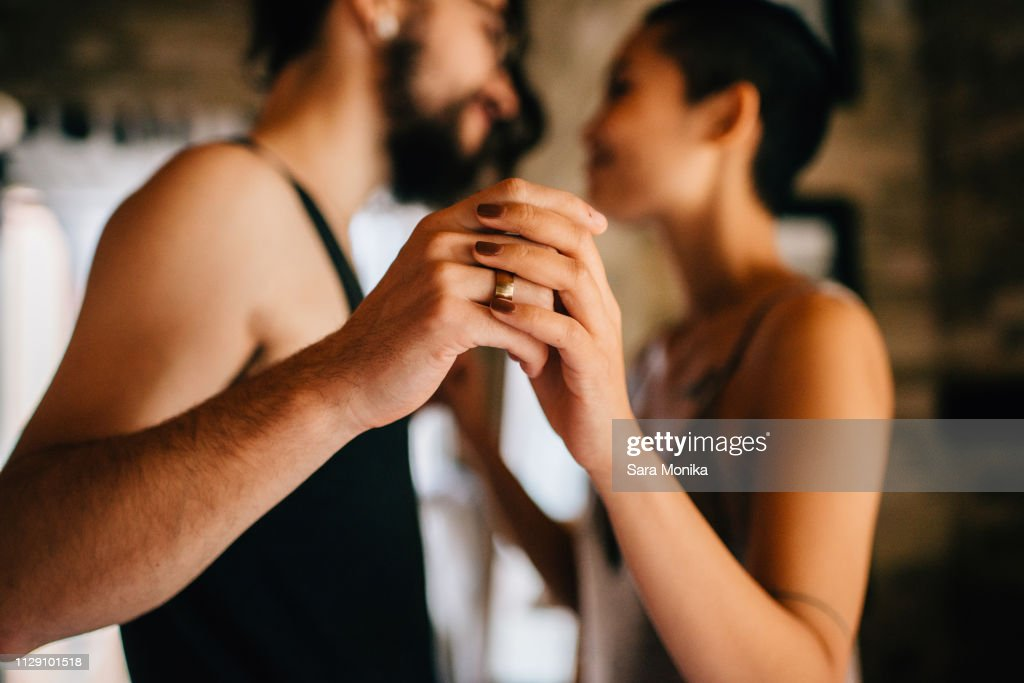 Couple slow dancing at home : Stock Photo