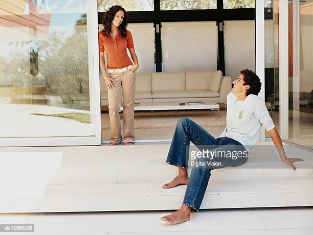 Couple Smiling at Each Other on the Patio of Their Home