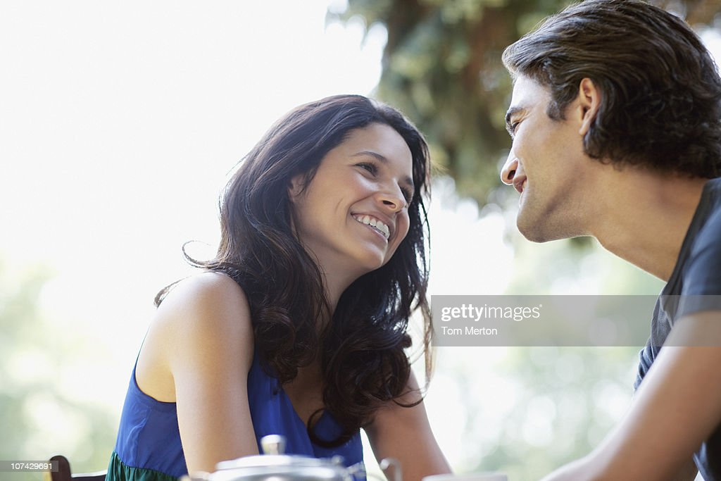 Couple smiling at each other : Stock Photo