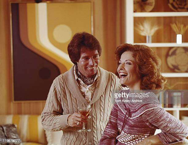 couple smiling, man holding drink - 1976 stock pictures, royalty-free photos & images