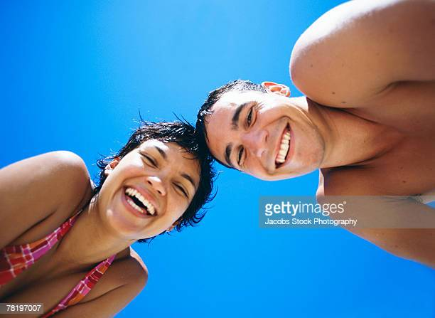 couple smiling - bend over cleavage stock photos and pictures