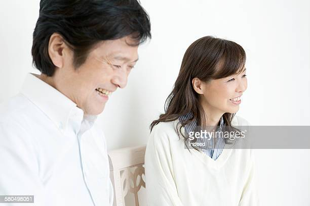 Couple smiling side by side