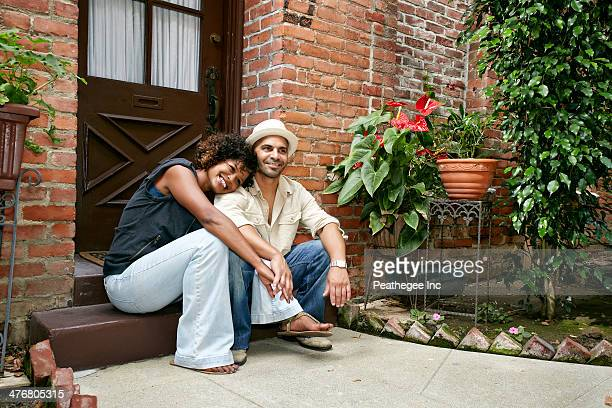 Couple smiling together on front stoop