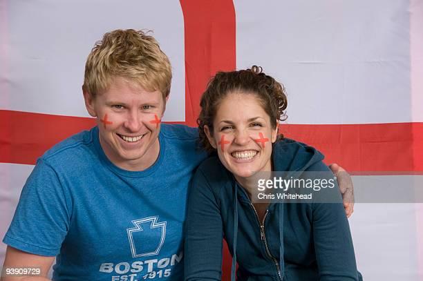 Couple smiling with English flag