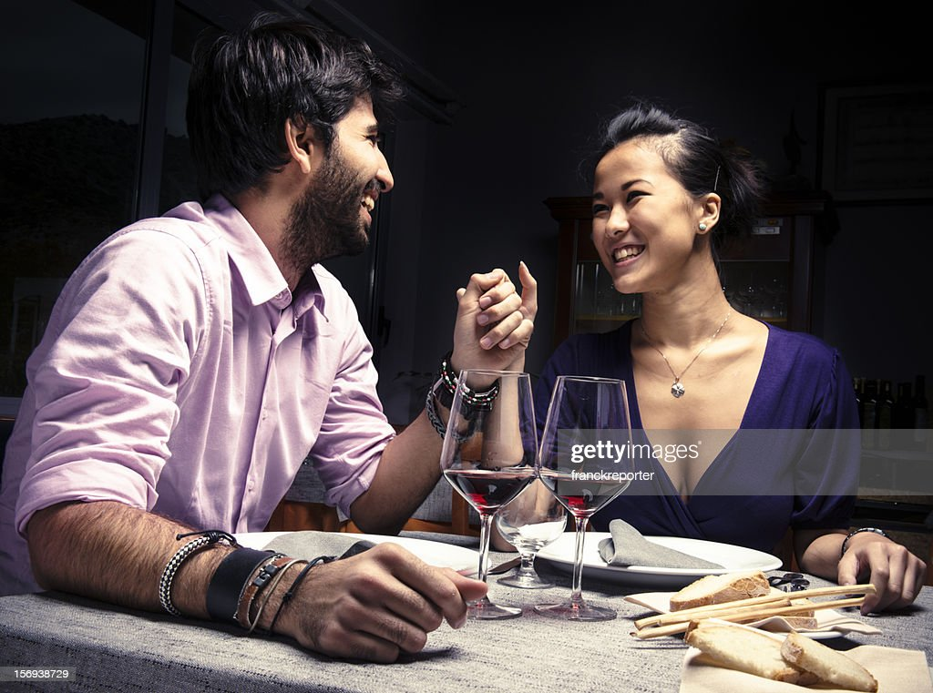 Couple smiling with red wine for St. Valentine : Stock Photo