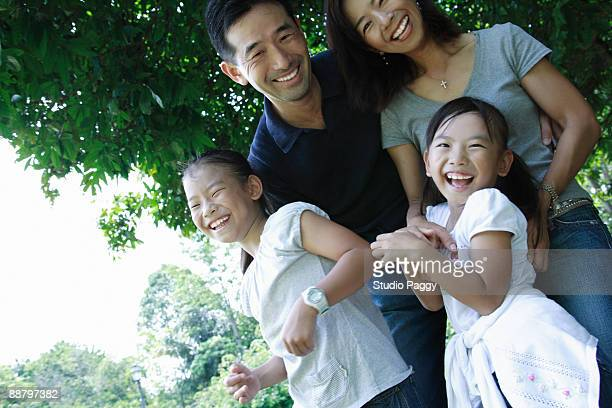 Couple smiling with their children in a park
