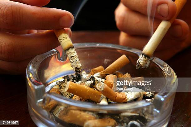 A couple smoke cigarettes in a public house in Bath on June 30 2007 in Somerset England From 6am July 1 smoking in all enclosed places such as cafes...