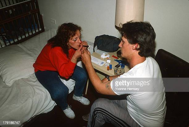 A couple smokes crack May 20 1986 in their room at a welfare hotel in New York City