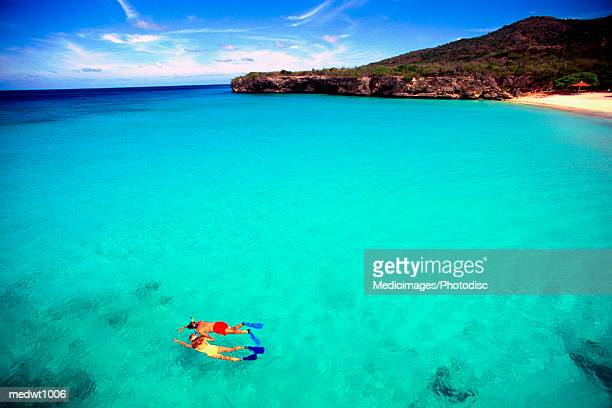 Couple snorkeling in crystal clear water off Knip Beach in Curacao