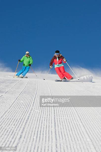 Couple snow skiing