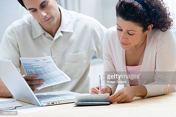 Couple sorting out home finances