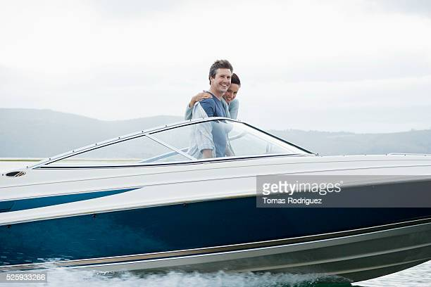 Couple speeding on motorboat
