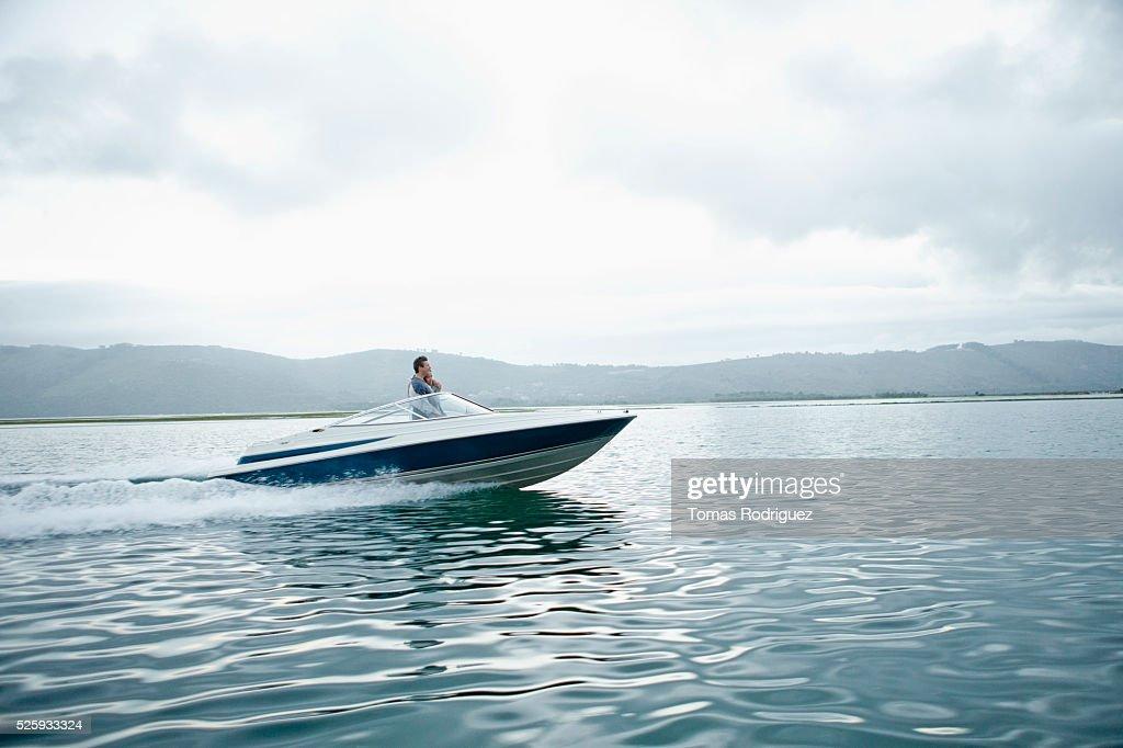 Couple speeding on motorboat : Stock Photo