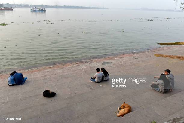 Couple spend time at a ghat of the river Ganga ahead of Valentines Day in Kolkata, India, 10 February, 2021.