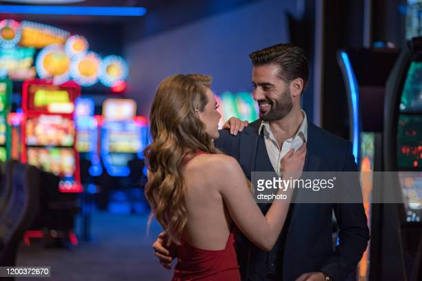 couple spending time at casino - gambling table stock pictures, royalty-free photos & images