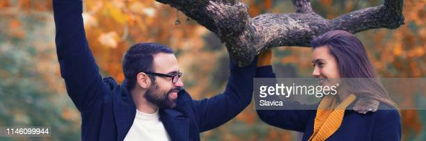 couple spending time in the autumn nature - heterosexual couple stock pictures, royalty-free photos & images