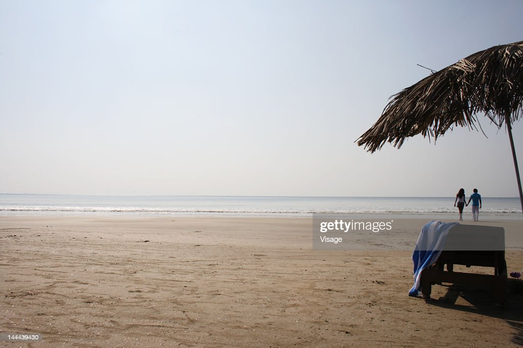 Couple spending time together at a beach : Stock Photo