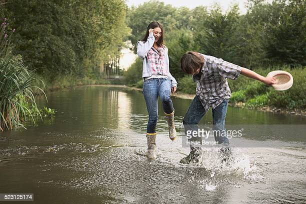 Couple Splashing in a River