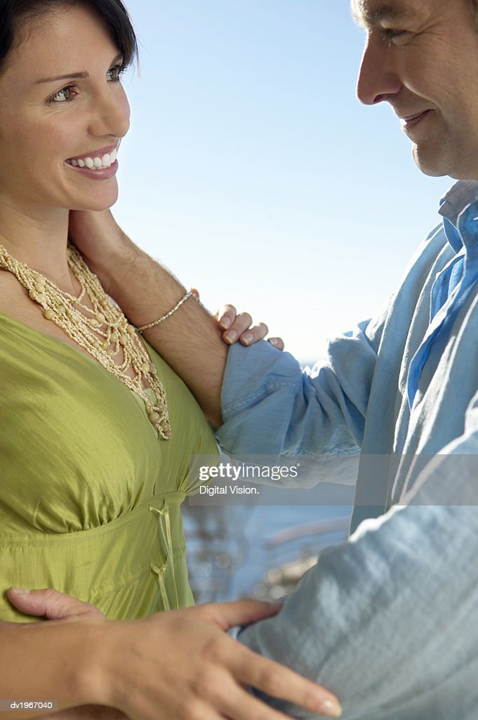 Couple Stand Face to Face, Gazing at Each Other and Embracing : Stock Photo