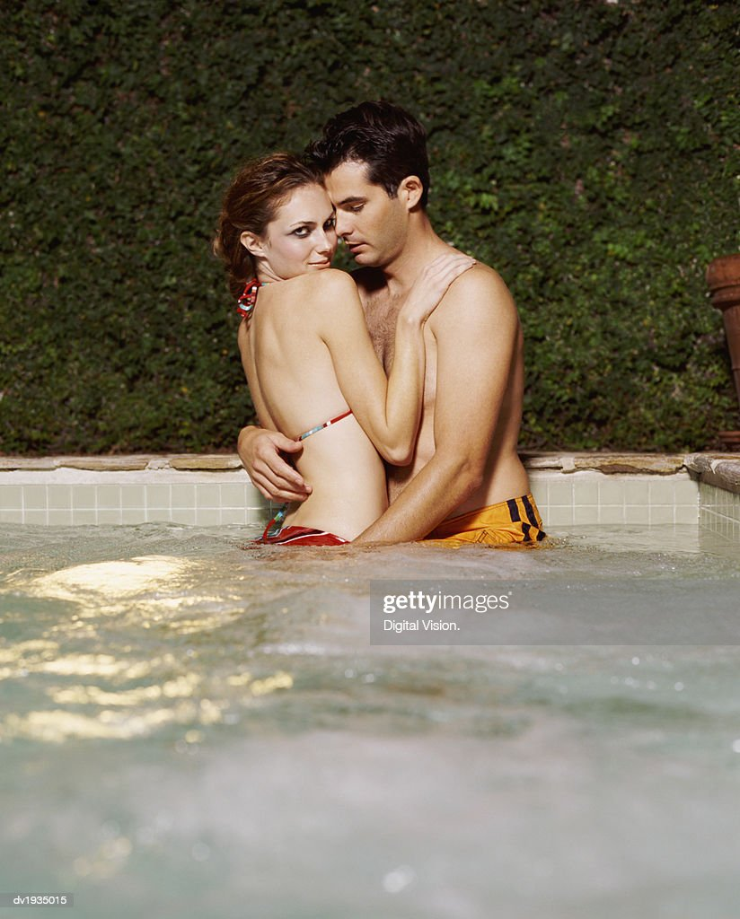 Couple Stand in a Jacuzzi Embracing Each Others : Stock Photo