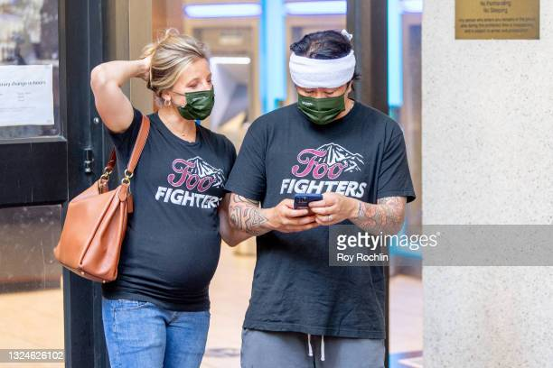 Couple stand in line wearing Foo Fighters shirts as Madison Square Garden reopens with the first full capacity concert since March 2020 on June 20,...