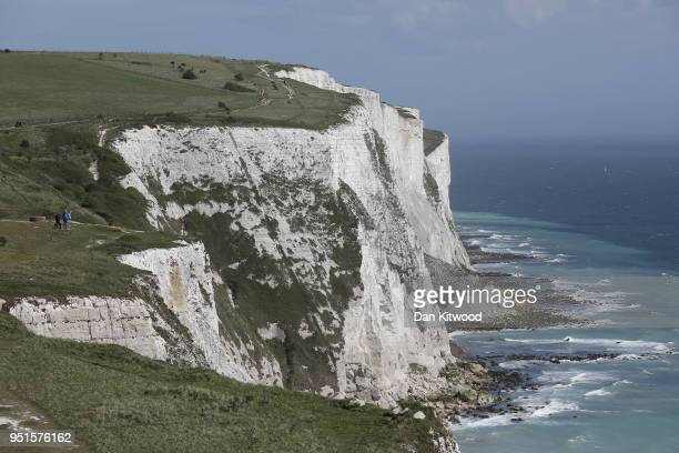 A couple stand on the top of the White Cliffs of Dover on April 26 2018 in Dover England The port town of Dover on England's south coast is the home...