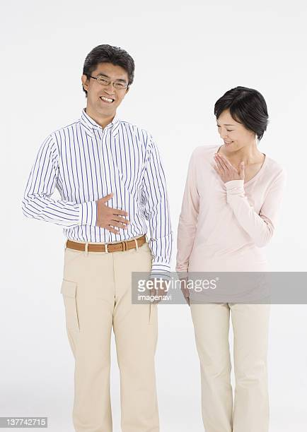 Couple standing and smiling