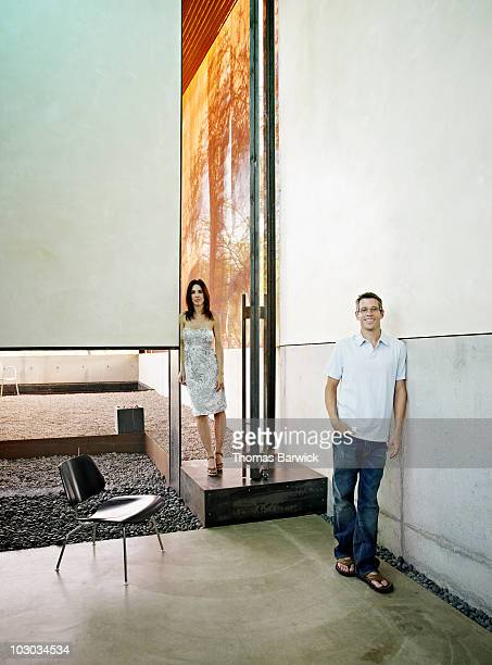 Couple standing at entry of contemporary home